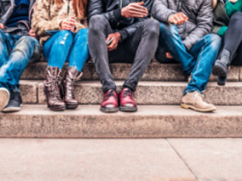 image: students sitting on steps