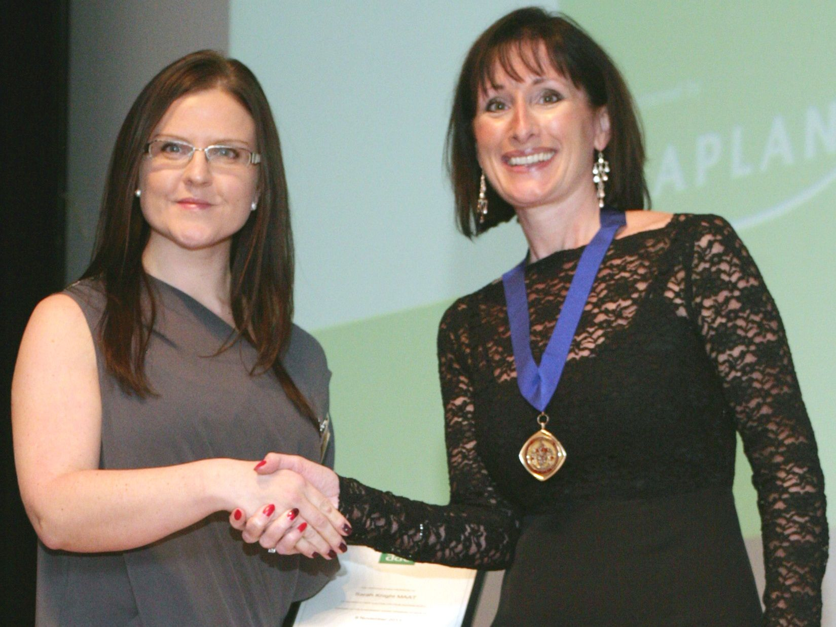 Sarah Knight MAAT is presented the 2013 AAT CPD prize by AAT Vice President, Dr Rachel Banfield (MA CPFA PGCHE FHEA FMAAT)