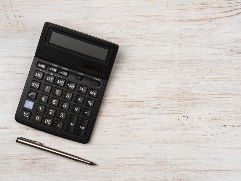 Calculator and pen on a desk